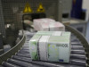 Bundles of euro banknotes move along a conveyer belt at the GSA Austria (Money Service Austria) company's headquarters in Vienna July 22, 2013. The GSA delivers new and collects old currency for the Austrian National Bank. REUTERS/Leonhard Foeger  (AUSTRIA - Tags: POLITICS BUSINESS) - RTX11V2F